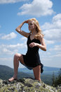 Free Woman In The Black Dress On Rock Royalty Free Stock Image - 5460146