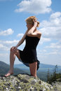 Free Woman In The Black Dress On Rock Stock Photography - 5460152