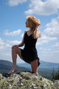 Free Woman In The Black Dress On Rock Royalty Free Stock Images - 5460169