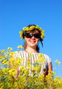 Free Beautiful Girl And Yellow Flowers Over A Blue Sky Royalty Free Stock Images - 5466539