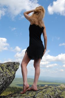 Woman In The Black Dress On Rock Stock Photos