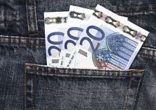 Euro Pocket Money In Blue Jeans Stock Photo