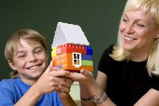 Free The Woman And The Boy Hold A Toy House Stock Photography - 5463042