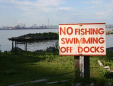 Free No Swimming Or Fishing With Industry Stock Image - 5463221