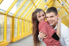Free Boy Embraces Girl On Footbridge Royalty Free Stock Photography - 5465007