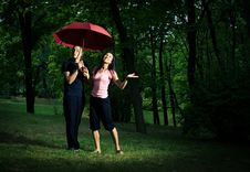 Free Young Couple Under Umbrella. Stock Image - 5466251
