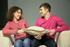 Free Couple Sit On Sofa With Pillow Stock Photography - 5466812