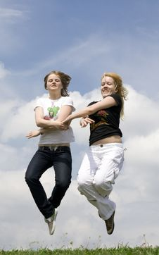 The Two Happy Jumping Girls Stock Photos