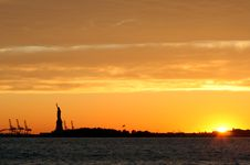 Free Statue Of Liberty And The Sunset Stock Image - 5468541