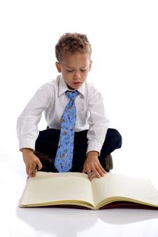 Free Young Boy Dressed As Businessman With Notebook Stock Photography - 5469522