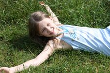 Young Girl Laying On The Green Grass Royalty Free Stock Images