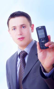 Free Businessman Holding Phone Royalty Free Stock Image - 5469696