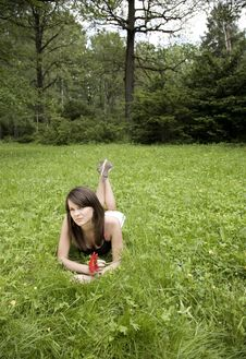 Free Smiling Woman Relaxes On The Grass Stock Photos - 5469853