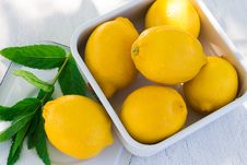 Free Fresh Lemon And A Sprig Of Mint Royalty Free Stock Photography - 54664607