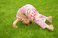 Free Little Girl Makes  Exercise On Grass Royalty Free Stock Photography - 5470017