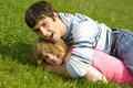 Free Young Happy Couple Laying On A Green Grass Royalty Free Stock Image - 5473396