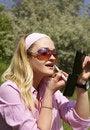 Free Woman Applying Lipstick Royalty Free Stock Image - 5473746