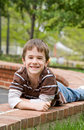 Free Little Boy Laying Down Smiling Stock Photo - 5475080