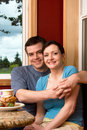 Free A Couple Smiling Over Breakfast - Vertical Stock Photo - 5479020