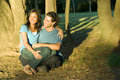 Free Couple Sitting Under A Shady Tree - Horizontal Royalty Free Stock Images - 5479299