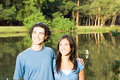 Free Smiling Couple In Front Of A Pond - Horizontal Stock Photos - 5479623