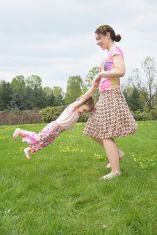 Free Mother Turns Daughter For Hands Stock Photography - 5470132