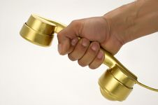 Free The Telephone Of Gold Colour In A Hand. Royalty Free Stock Photo - 5470895