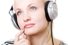 Free A Pensive Girl In Headphones Royalty Free Stock Images - 5471149