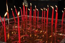 Free Burning Candles In The Water Pan Stock Photo - 5471450