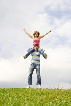 Free Young Happy Couple Standing On A Green Grass Royalty Free Stock Photos - 5473398