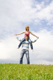 Free Young Happy Couple Standing On A Green Grass Stock Image - 5473401