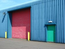 Factory With Colourful Doors And Posts Royalty Free Stock Photo