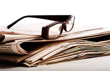 Free Reading Glasses On Newspapers Stock Photo - 5478450