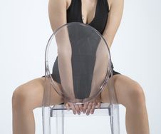 Free Woman Sitting On A Chair Royalty Free Stock Photography - 5478477