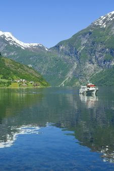 Boat In The Ocean, Geiranger Fjord Royalty Free Stock Photo