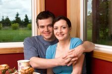 Free A Couple Smiling Over Breakfast - Horizontal Royalty Free Stock Photography - 5479227