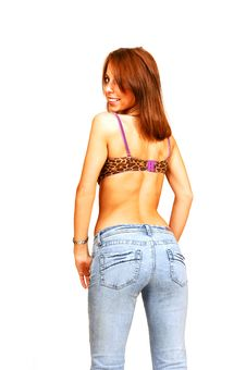 Free Standing Woman In Bra And Jeans. Royalty Free Stock Image - 5479286