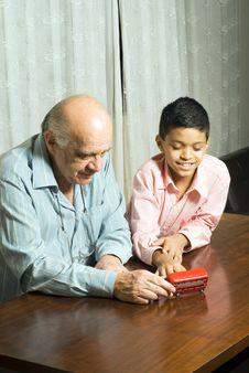Grandfather And Grandson Sitting On Table - Vertic Royalty Free Stock Photography