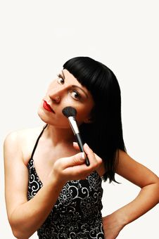 Young Woman Putting Make-up On. Stock Image