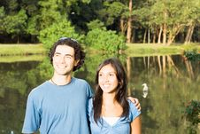 Smiling Couple In Front Of A Pond - Horizontal Stock Photos