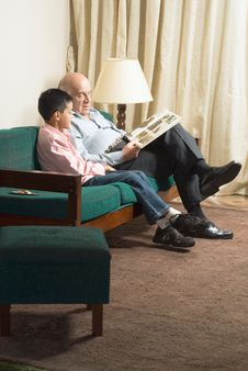 Free Grandfather And Grandson On Couch Reading Royalty Free Stock Images - 5479639
