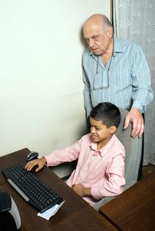Free Grandfather And Grandson Sit By The Computer Stock Image - 5479651