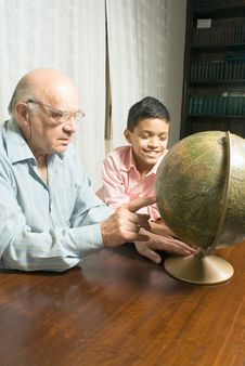 Free Grandfather And Grandson Sitting At The Table Royalty Free Stock Photos - 5479758