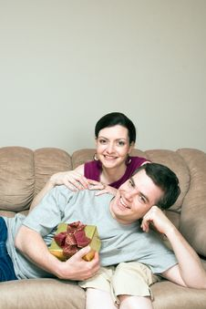 Free Man With Gift Box Lying On Woman S Lap-Vertic Stock Images - 5479854