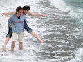Free Young Couple Carrying Piggyback On Seashore Stock Image - 5482541