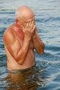 Free Eldery Man In Water Stock Photography - 5488692