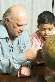 Free Grandfather And Grandson Look At A Globe - Vertica Stock Photo - 5480040
