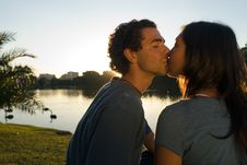 Free Kissing By A Pond. - Horizontal Stock Image - 5480141