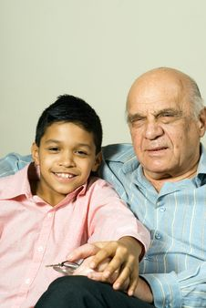 Grandfather And Grandson On Couch - Vertical Royalty Free Stock Photography