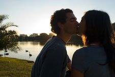 Free Couple Kissing In Front Of Pond.Close Up-Horizont Stock Images - 5480254
